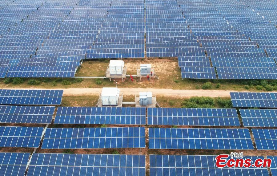An aerial view of a photovoltaic power plant in Taihe County, East China's Jiangxi Province, May 23, 2018. The 30MW project, with an investment of 240 million yuan ($37.6 million), was part of efforts to help eradicate poverty in the county. (Photo: China News Service/Deng Heping)