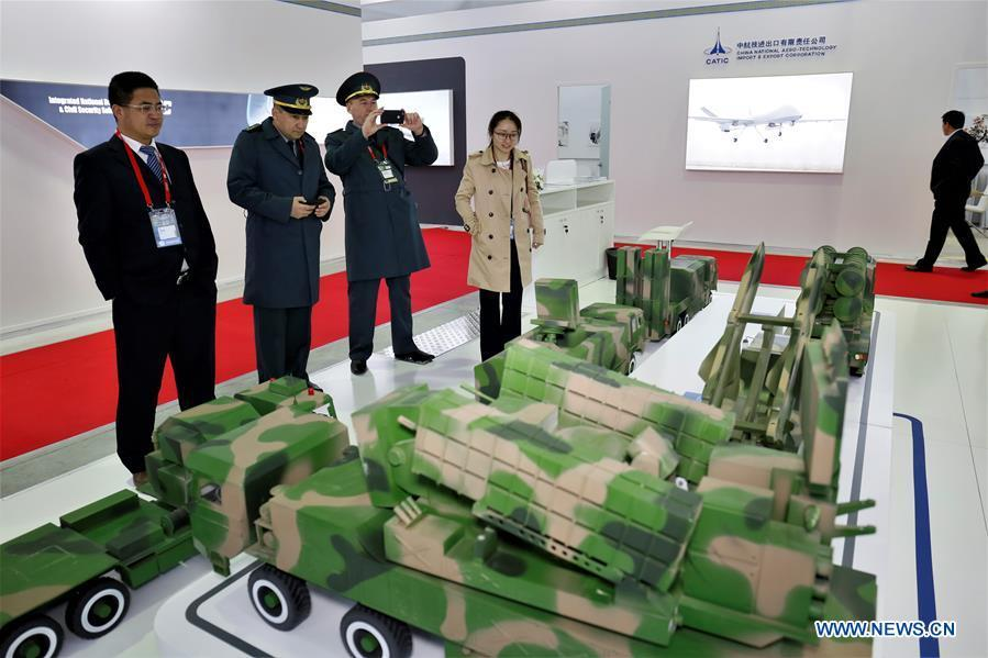 People look at the exhibits of a Chinese company at the Kazakhstan Defense Exhibition in Astana, capital of Kazakhstan, May 23, 2018. Seven Chinese military trade companies took their best products to participate in the exhibition held in Kazakhstan from May 23 to 26. (Xinhua/Aibek Abilov)