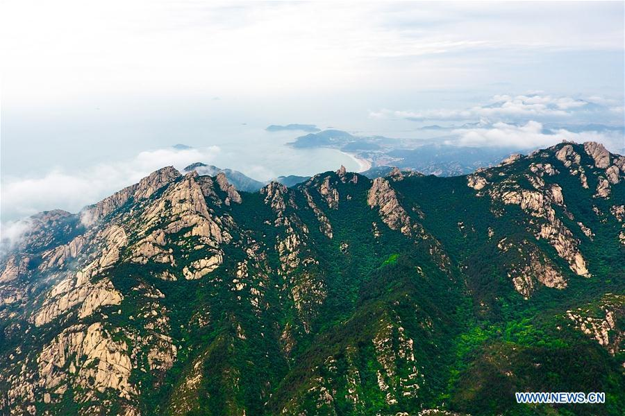 Aerial photo taken on May 21, 2018 shows the Laoshan Mountain in Qingdao, east China\'s Shandong Province. (Xinhua/Guo Xulei)