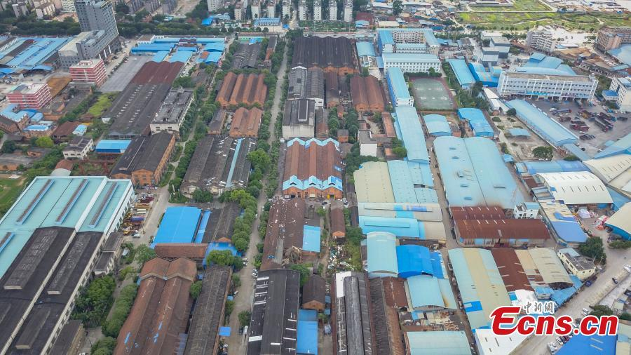 A view of a former walking tractor factory in Nanning City, South China's Guangxi Zhuang Autonomous Region. Xu Xiaomao, Ouyang Dinghua and Wei Ning rented the space in April 2015 and renovated it for their startup in video and music production. The closed tractor factory was built in 1956 of the former Soviet style. (Photo: China News Service/Liu Yujun)