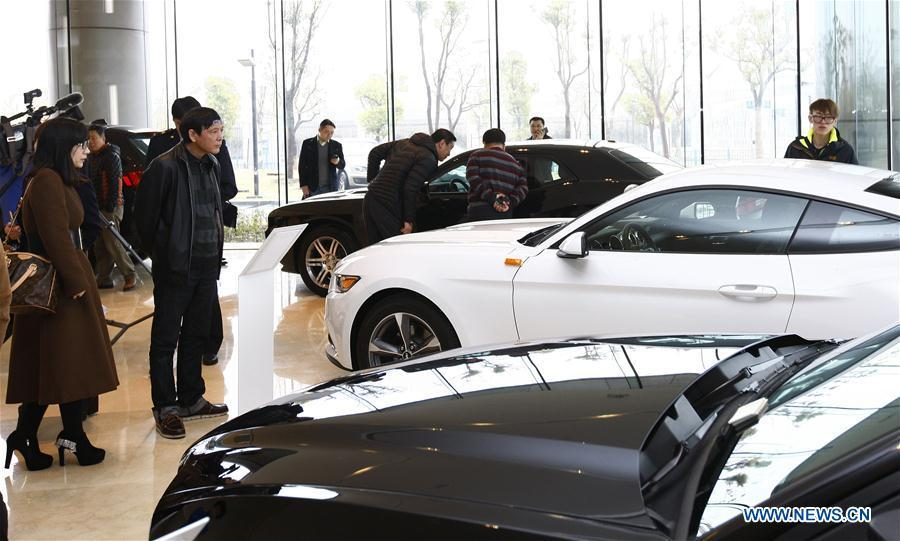 People visit an exhibition center for imported cars at the China (Shanghai) Pilot Free Trade Zone in Shanghai, east China, Feb. 15, 2015. This year marks the 40th anniversary of China\'s starting to implement reform and opening up policy. (Xinhua/Fang Zhe)