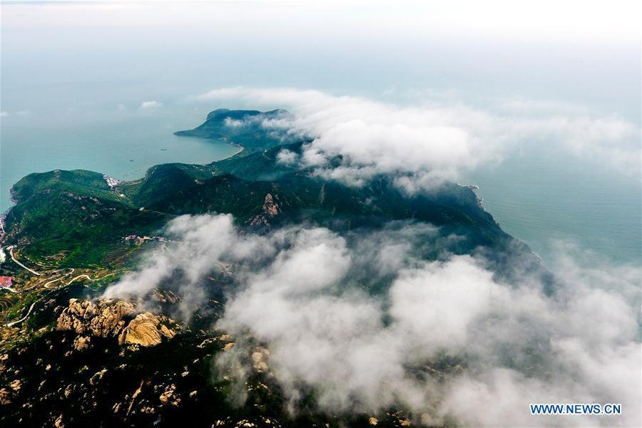 Aerial photo taken on May 21, 2018 shows sea of clouds over the Laoshan Mountain in Qingdao, east China\'s Shandong Province. (Xinhua/Guo Xulei)