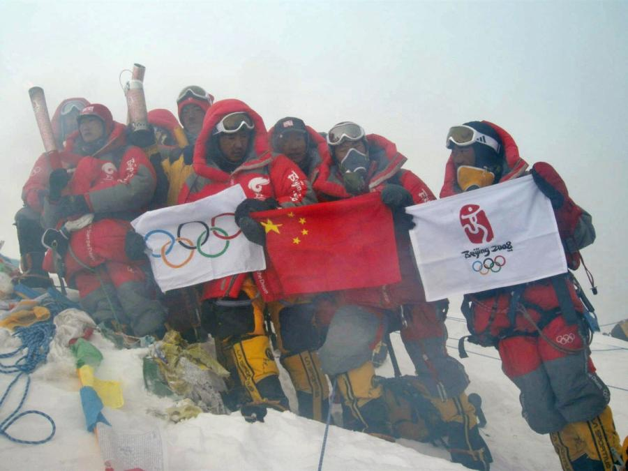 Beijing Olympic Torch is displayed by China Tibet Climbing Team on the summit of Mount Qomolangma on May 8, 2008. The Chinese climbers displayed the Chinese flag, the Olympic Flag and Beijing Olympic Emblem Flag on the summit. (Photo/Xinhua)