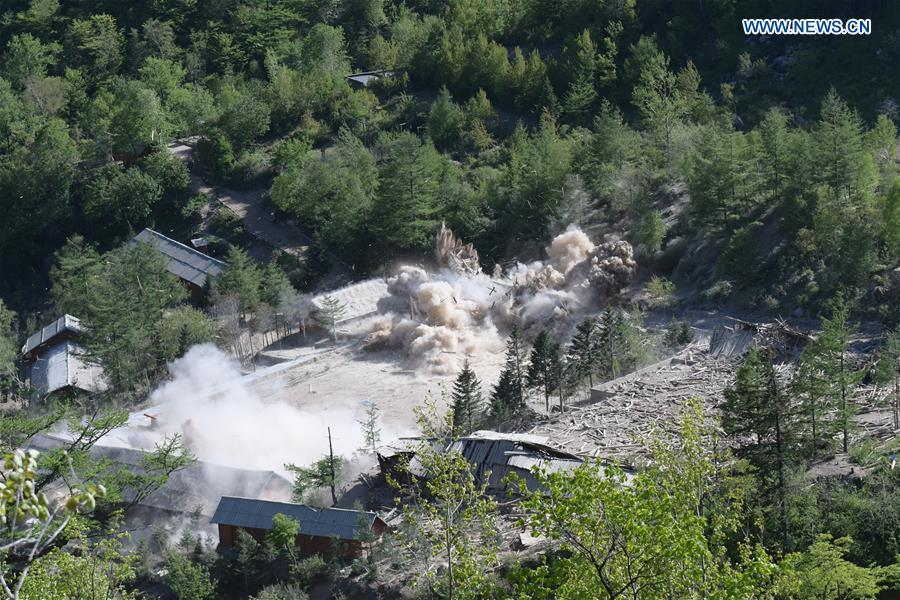 Photo taken on May 24, 2018 shows explosions at the nuclear test site of Punggye-ri, the Democratic People\'s Republic of Korea. The Democratic People\'s Republic of Korea has confirmed the demolition of its nuclear test site at Punggye-ri on Thursday, saying that all the tunnels have been collapsed by explosions and their entrances completely closed, according to the Korean Central News Agency (KCNA). (Xinhua/Cheng Dayu)     Prev 1 2 3 4 5 6