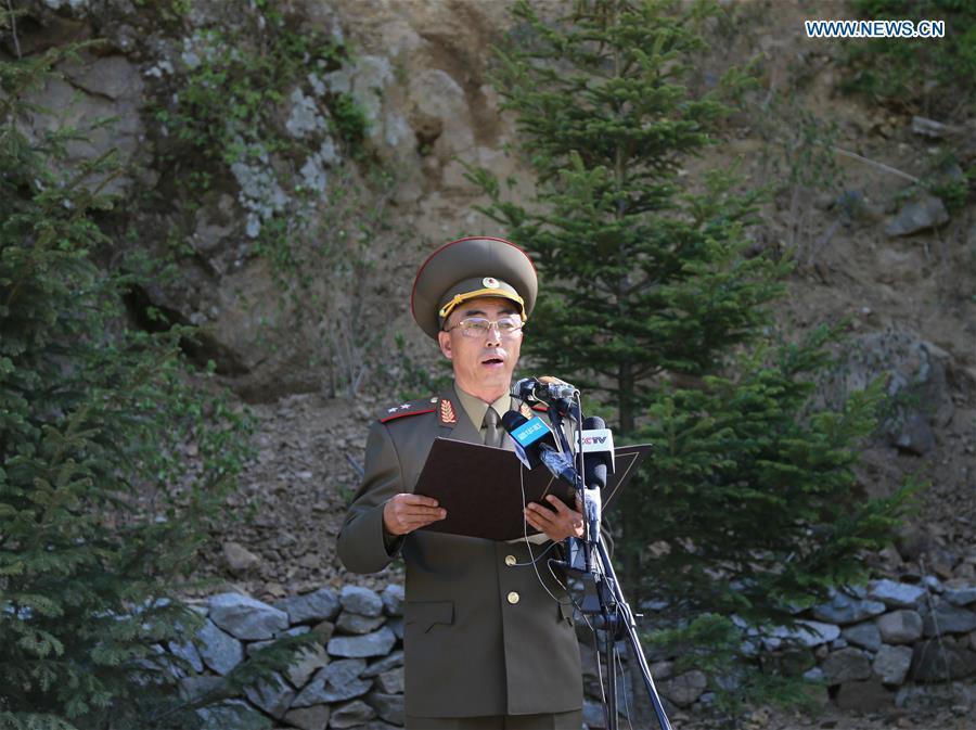 An official of the Nuclear Weapons Institute of the Democratic People\'s Republic of Korea (DPRK) announces a statement at the nuclear test site of Punggye-ri, the Democratic People\'s Republic of Korea, on May 24, 2018. The Democratic People\'s Republic of Korea has confirmed the demolition of its nuclear test site at Punggye-ri on Thursday, saying that all the tunnels have been collapsed by explosions and their entrances completely closed, according to the Korean Central News Agency (KCNA). (Xinhua/Cheng Dayu)