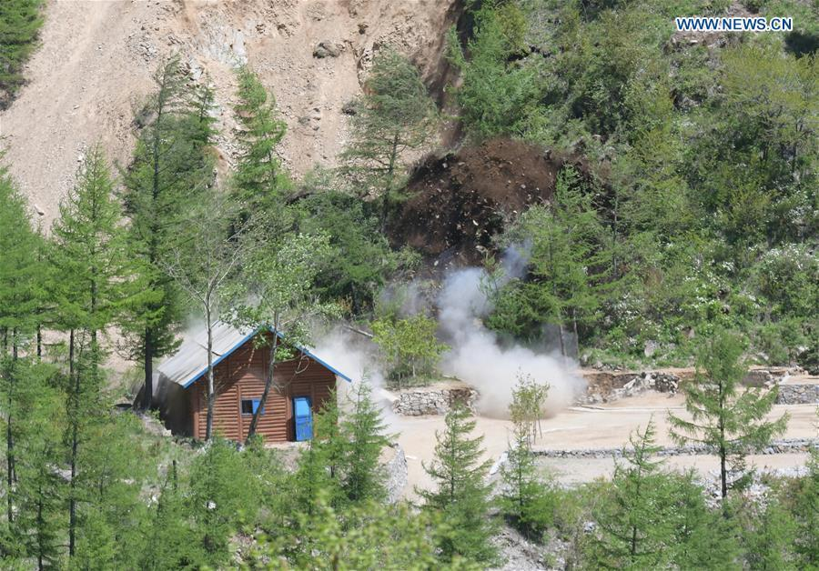 Photo taken on May 24, 2018 shows explosions of the No. 2 tunnel at the nuclear test site of Punggye-ri, the Democratic People\'s Republic of Korea. The Democratic People\'s Republic of Korea has confirmed the demolition of its nuclear test site at Punggye-ri on Thursday, saying that all the tunnels have been collapsed by explosions and their entrances completely closed, according to the Korean Central News Agency (KCNA). (Xinhua/Cheng Dayu)
