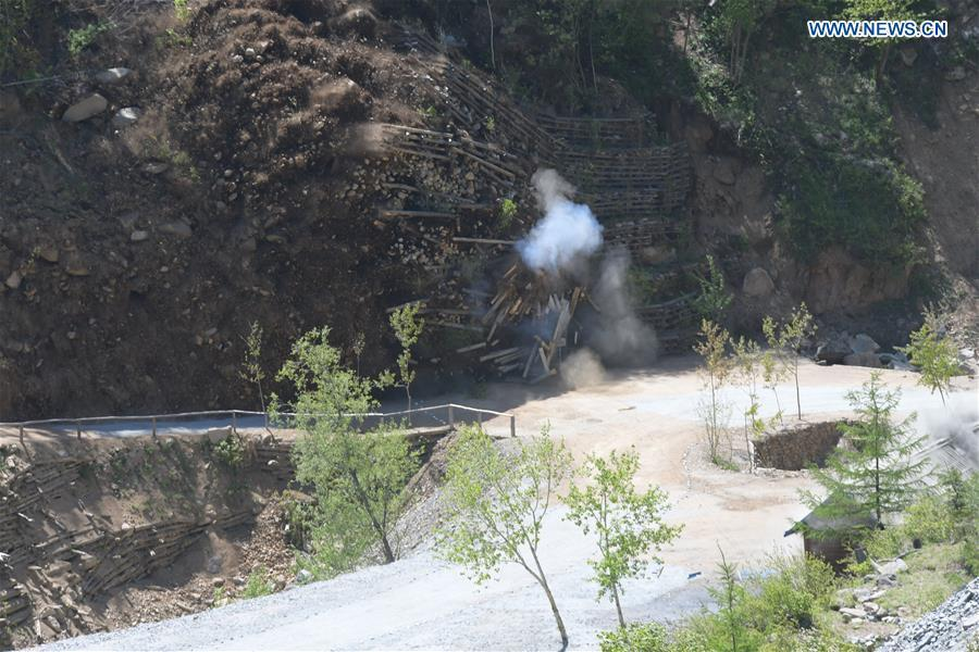 Photo taken on May 24, 2018 shows explosions of the No. 4 tunnel at the nuclear test site of Punggye-ri, the Democratic People\'s Republic of Korea. The Democratic People\'s Republic of Korea has confirmed the demolition of its nuclear test site at Punggye-ri on Thursday, saying that all the tunnels have been collapsed by explosions and their entrances completely closed, according to the Korean Central News Agency (KCNA). (Xinhua/Cheng Dayu)