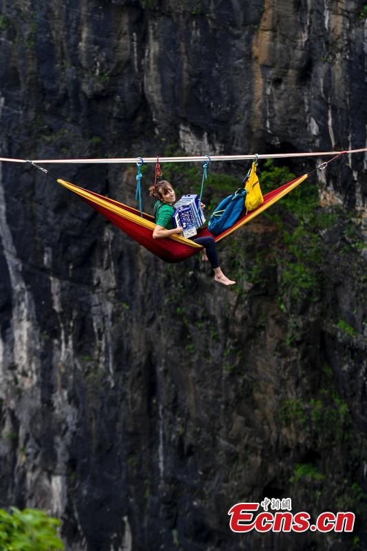 Members of the band HouleDouse perform on slacklines across the 1,400-meter-high cliffs of Tianmen Mountain in Zhangjiajie National Forest Park in central China\'s Hunan province, on Wednesday, May 23, 2018. HouleDouse have made their Asian debut in China, in a show that combines extreme sports with music. (Photo: China News Service/ Yang Huafeng)