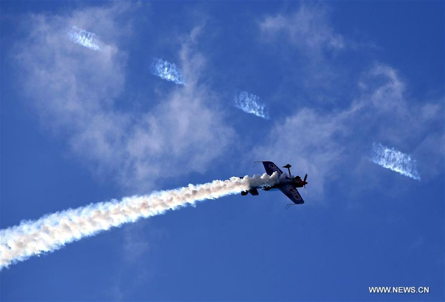 An aerobatics aircraft performs during a rehearsal for the 10th Air Sports Cultural Tourism Festival in Anyang, central China\'s Henan Province, May 24, 2018. The three-day air show begins on May 25. (Xinhua/Li An)