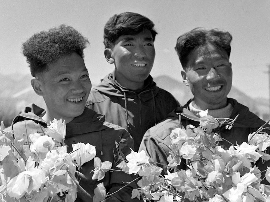 Chinese mountaineers Wang Fuzhou (right), Kunbo (middle) and Qu Yinhua are welcomed with flowers after they conquered the summit on June 7, 1960. The trio made their first trip to Mount Qomolangma, known as Mount Everest in the West, from the North Slope On May 25, 1960. This was the first time that somebody had ascended the world's highest peak from the North Slope. Since then, more Chinese mountaineers were inspired to march toward Mount Qomolangma. (Photo/Xinhua)