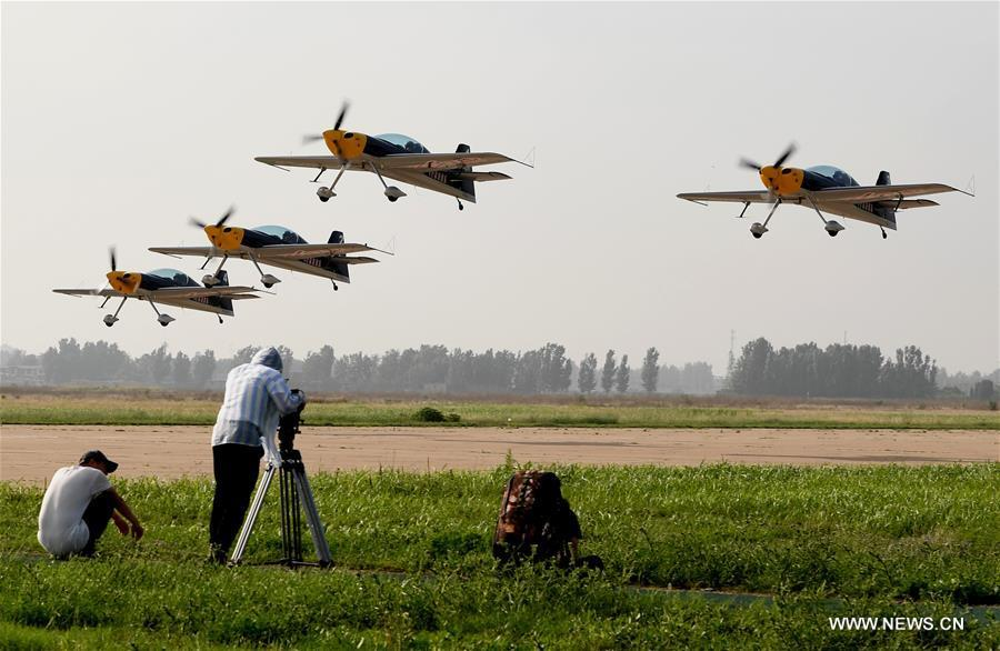 Jets piloted by aviation enthusiasts take off during a rehearsal for the 10th Air Sports Cultural Tourism Festival in Anyang, central China\'s Henan Province, May 24, 2018. The three-day air show begins on May 25. (Xinhua/Li An)