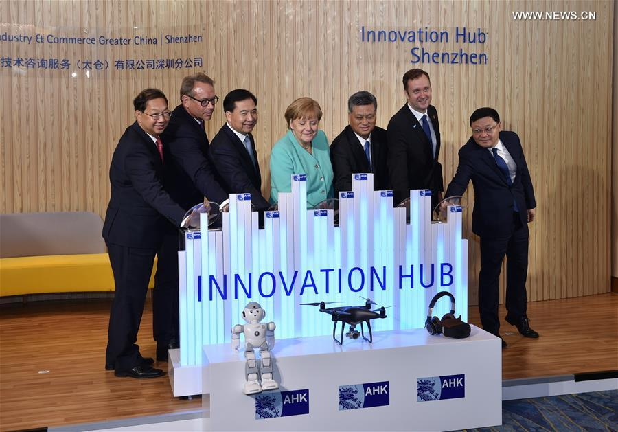 German Chancellor Angela Merkel (C) attends the opening ceremony of the Shenzhen innovation hub of the German Industry and Commerce Ltd. in Shenzhen, south China\'s Guangdong Province, May 25, 2018. (Xinhua/Mao Siqian)