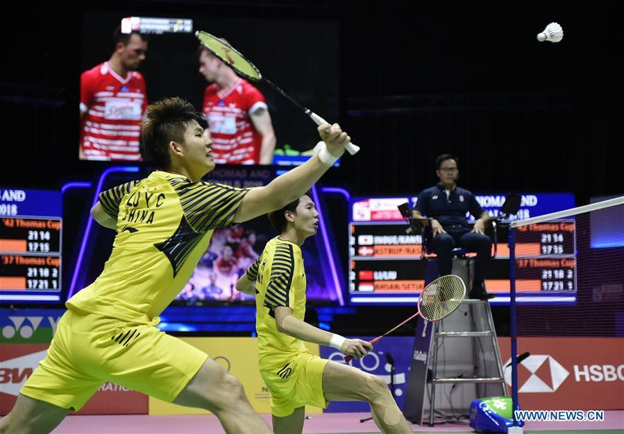 Li Junhui and Liu Yuchen (L) of team China hit a return during the BWF Thomas Cup 2018 semifinal against Mohammad Ahsan and Hendra Setiawan of team Indonesia in Bangkok, Thailand, on May 25, 2018. Team China advanced to the final with 3-1.(Xinhua/Wang Shen)