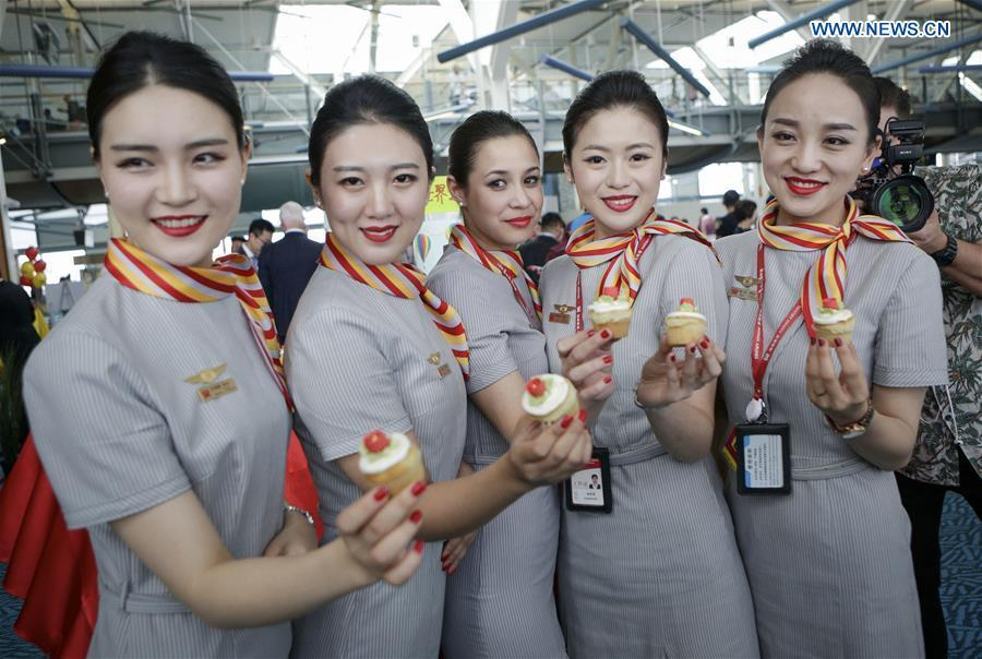 Flight attendants of China\'s Hainan Airlines pose for photos after they arrived at Vancouver International Airport in Vancouver, Canada, May 25, 2018. A direct flight between Tianjin and Vancouver was launched on Friday. Flight HU7959, operated by Hainan Airlines, is the first direct passenger air route linking Tianjin with North America. (Xinhua/Liang Sen)