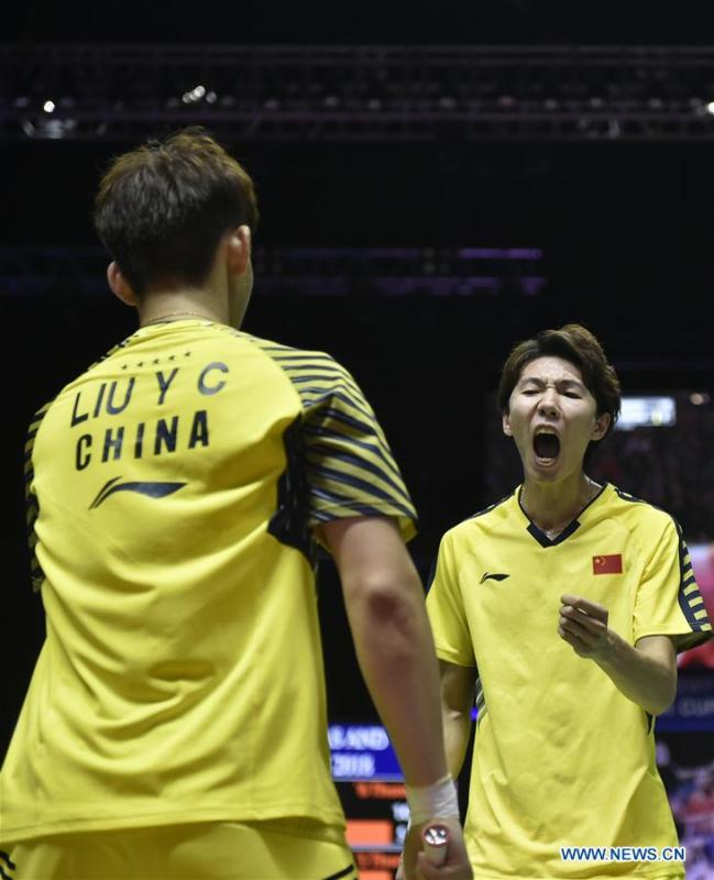 Li Junhui (R) and Liu Yuchen of team China celebrate after winning the BWF Thomas Cup 2018 semifinal against Mohammad Ahsan and Hendra Setiawan of team Indonesia in Bangkok, Thailand, on May 25, 2018. Team China advanced to the final with 3-1.(Xinhua/Wang Shen)