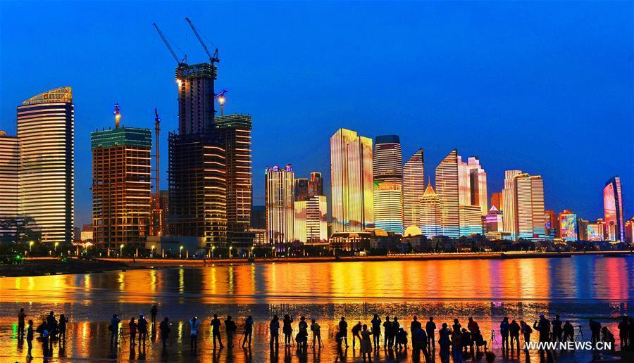 Photo taken on May 26, 2018 shows a night view of the Qianhai area in Qingdao, a coastal city in east China\'s Shandong Province which will host a summit of the Shanghai Cooperation Organization next month. (Xinhua/Wang Haibin)