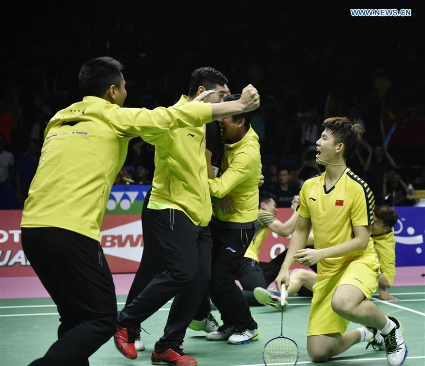 Team China celebrate after winning the final against team Japan at the Thomas Cup badminton tournament in Bangkok, Thailand, on May 27, 2018. Team China won the final 3-1 and claimed the title of the event. (Xinhua/Wang Shen)