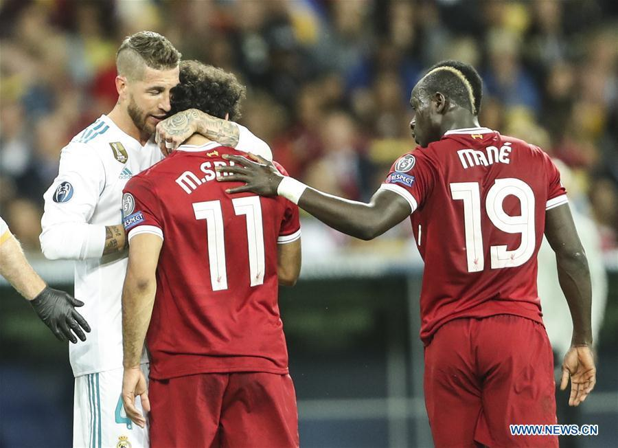 Sergio Ramos (L) of Real Madrid hugs Mohamed Salah of Liverpool during the UEFA Champions League final match between Liverpool and Real Madrid in Kiev, Ukraine on May 26, 2018. Real Madrid claimed the title with 3-1. (Xinhua/Wuzhuang)
