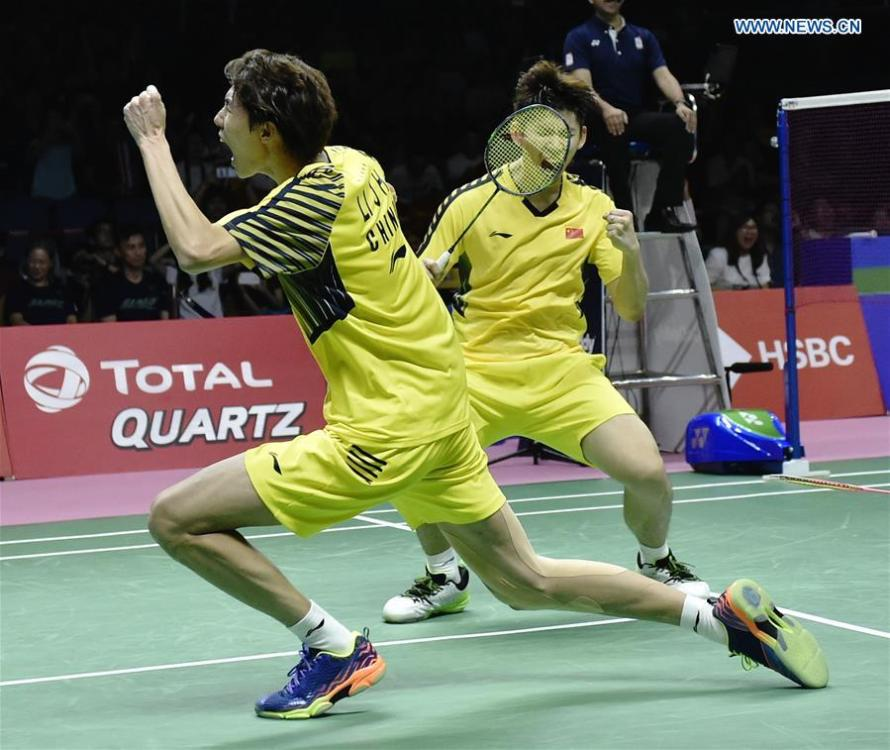 China\'s Li Junhui (front)/Liu Yuchen celebrate after winning the doubles match against Japan\'s Keigo Sonoda/Yuta Watanabe in the final of the Thomas Cup badminton tournament in Bangkok, Thailand, on May 27, 2018. Team China won the final 3-1 and claimed the title of the event. (Xinhua/Wang Shen)