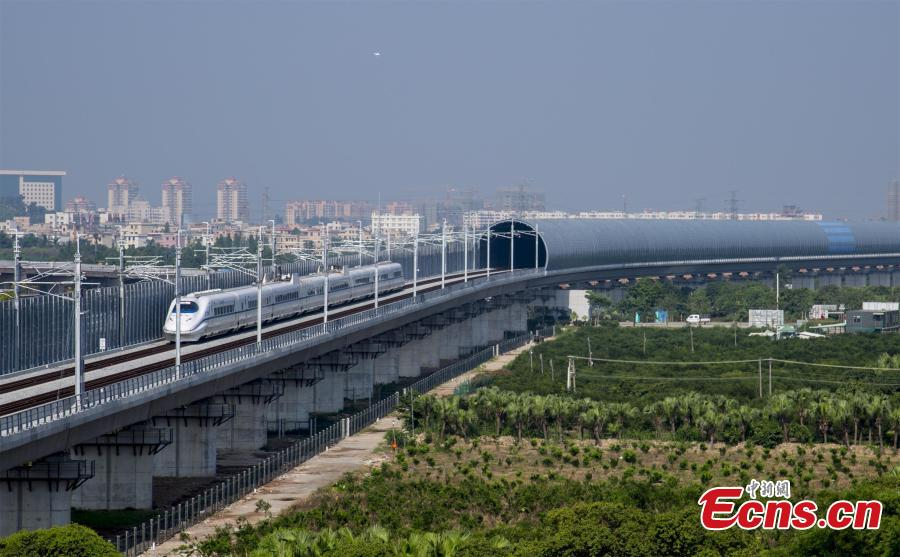 A high-speed train makes a pilot run from Jiangmen City to Zhanjiang City in Guangdong Province, May 28, 2018. Simulation exercises including malfunction and emergency case handling during the pilot run will provide scientific evidence for further operation. (Photo: China News Service/Yang Sheng)