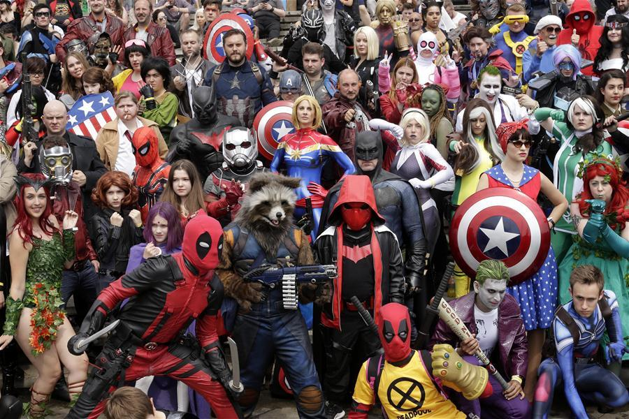 People dressed in costumes pose for a photo at the MCM Comic Con at the ExCel center in London, Britain, on May 27, 2018. The MCM Comic Con was held in London from May 25 to May 27, attacting lots of comic fans to the popular culture gathering. (Xinhua/Tim Ireland)