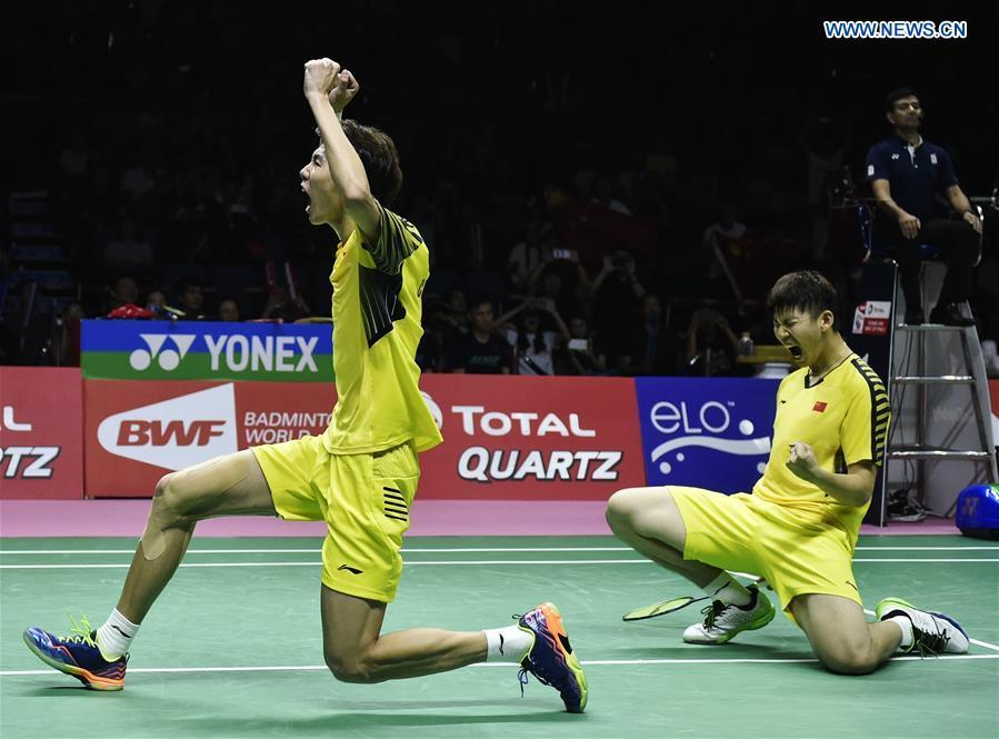 China\'s Li Junhui (L)/Liu Yuchen celebrate after winning the doubles match against Japan\'s Keigo Sonoda/Yuta Watanabe in the final of the Thomas Cup badminton tournament in Bangkok, Thailand, on May 27, 2018. Team China won the final 3-1 and claimed the title of the event. (Xinhua/Wang Shen)
