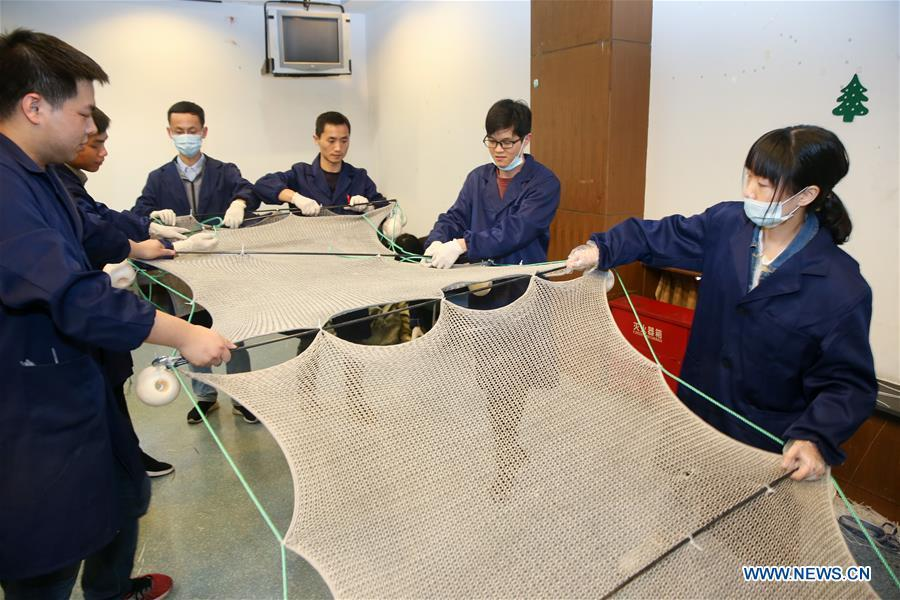 Team captained by Huang Fuqiang, chief researcher at the Shanghai Institute of Ceramics of Chinese Academy of Sciences, assembles the composite material at the Shanghai Institute of Ceramics of Chinese Academy of Sciences in east China\'s Shanghai, April 24, 2018. A new composite material developed by a group of Chinese researchers has proved highly effective in cleaning water contaminated by organics. (Xinhua/Ding Ting)