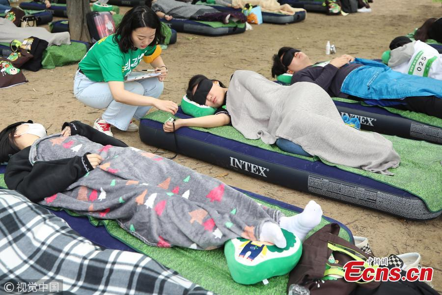 A sleeping contest is held in Seoul Forest in South Korea, May 27, 2018. More than 8,500 people applied to join the contest for its third edition, with the longest sleeper the winner. (Photo/VCG)