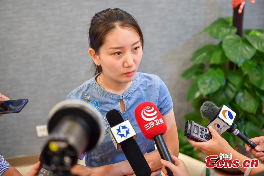 Shi Jiayu, a 25-year-old woman from Beijing, talks to reporters after becoming the first on the Chinese mainland to receive Gardasil 9, a vaccine for human papillomavirus (HPV), at United Family Healthcare in Boao, South China's Hainan Province, May 30, 2018. (Photo: China News Service/Luo Yunfei)