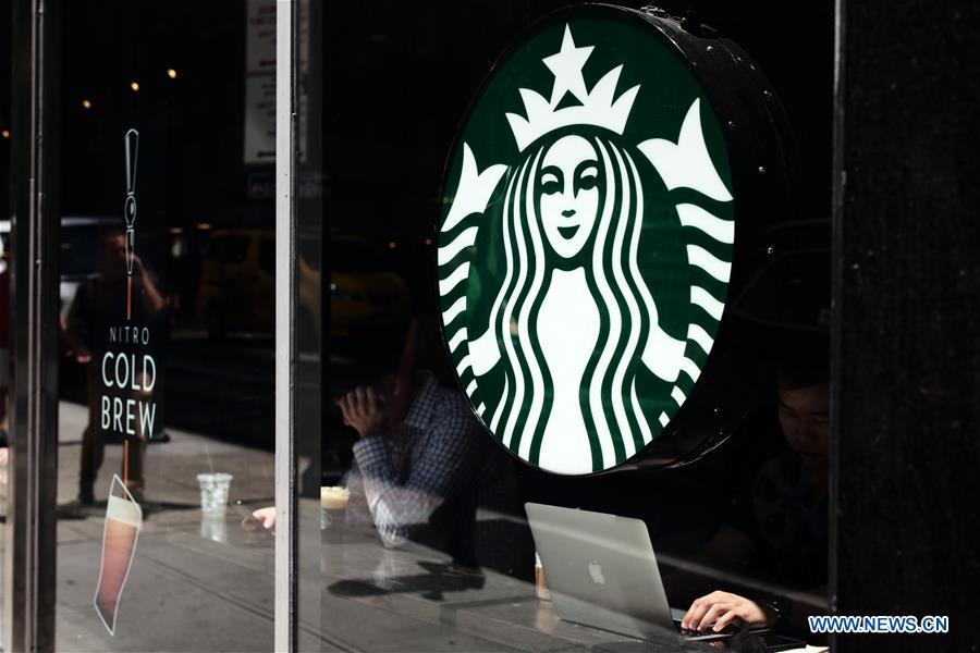 A Starbucks logo is pictured in Manhattan, New York, the United States, May 29, 2018. Starbucks closed about 8,000 company-owned stores in the United States on Tuesday afternoon to offer nearly 175,000 employees a mandatory anti-bias training. (Xinhua/Li Muzi)