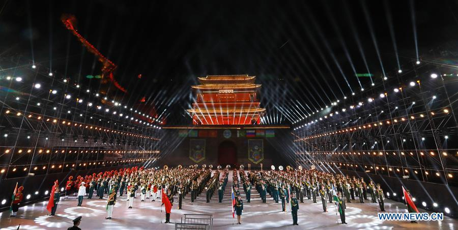 Eight military bands from different countries perform at the opening ceremony of a military band festival of the Shanghai Cooperation Organization (SCO) at a square of the Juyongguan Pass of the Great Wall in Beijing, capital of China, April 24, 2018. The 18th Shanghai Cooperation Organization (SCO) Summit is scheduled for June 9 to 10 in Qingdao, a coastal city in east China\'s Shandong Province. Since China took over the rotating presidency of the SCO last June, more than 160 activities including a series of important institutional meetings and multilateral events have been held so far. (Xinhua/Ju Zhenhua)