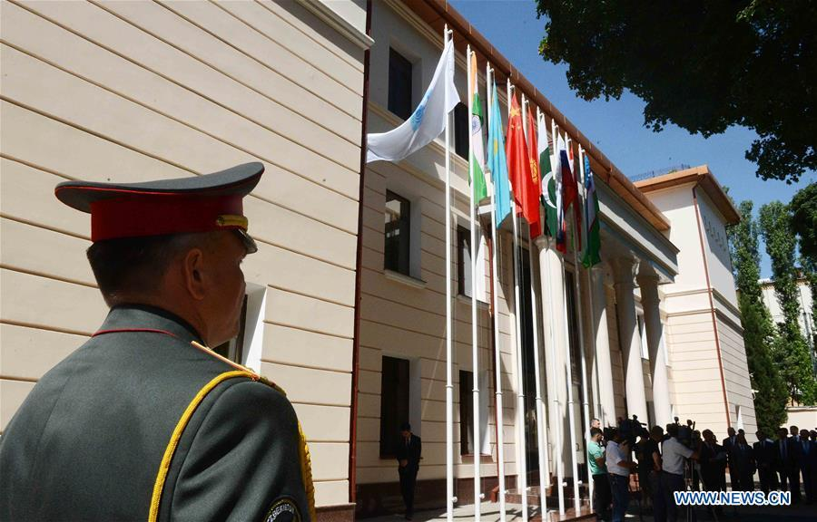 Flags of India and Pakistan are hoisted after they were accepted as full members at Regional Anti-Terrorist Structure of Shanghai Cooperation Organization in Tashkent, Uzbekistan, June 15, 2017. The 18th Shanghai Cooperation Organization (SCO) Summit is scheduled for June 9 to 10 in Qingdao, a coastal city in east China\'s Shandong Province. Since China took over the rotating presidency of the SCO last June, more than 160 activities including a series of important institutional meetings and multilateral events have been held so far. (Xinhua/Sadat)