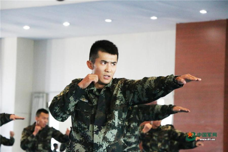 Photo taken on May 28, 2018 at the Great Wall 2018 Anti-terror International Forum shows Special Police of China members demonstrating anti-terror training programs at the Special Police Academy of the Chinese People\'s Armed Police Force in Beijing. The training included shooting and forced airplane cabin entry. (Photo/81.cn)