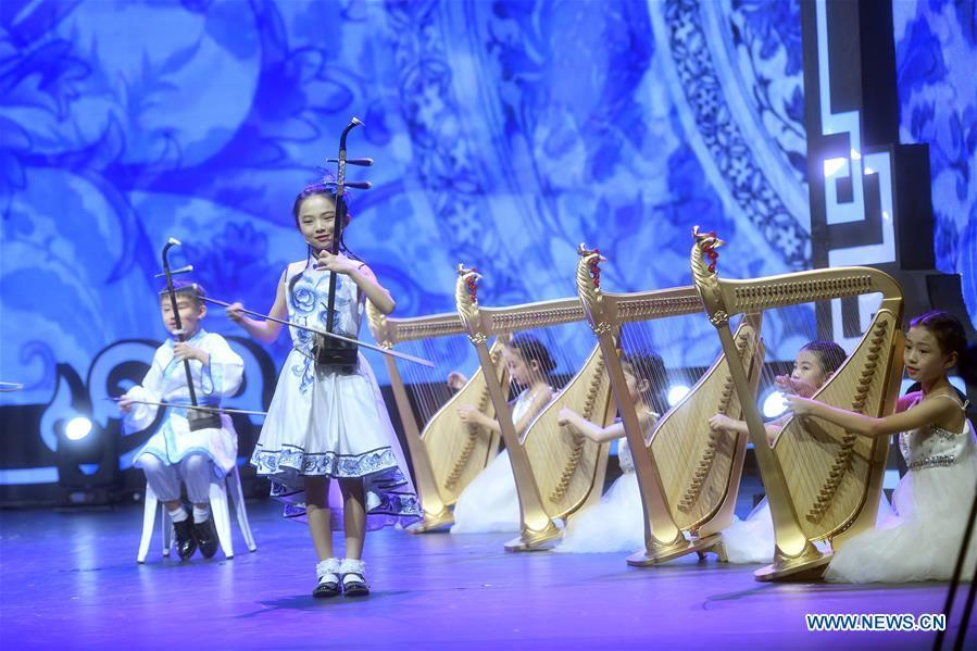 Children from China perform during a cultural exchange activity among youth from Shanghai Cooperation Organization (SCO) member countries in Beijing, capital of China, Aug. 22, 2017. The 18th Shanghai Cooperation Organization (SCO) Summit is scheduled for June 9 to 10 in Qingdao, a coastal city in east China\'s Shandong Province. Since China took over the rotating presidency of the SCO last June, more than 160 activities including a series of important institutional meetings and multilateral events have been held so far. (Xinhua/Jin Liangkuai)