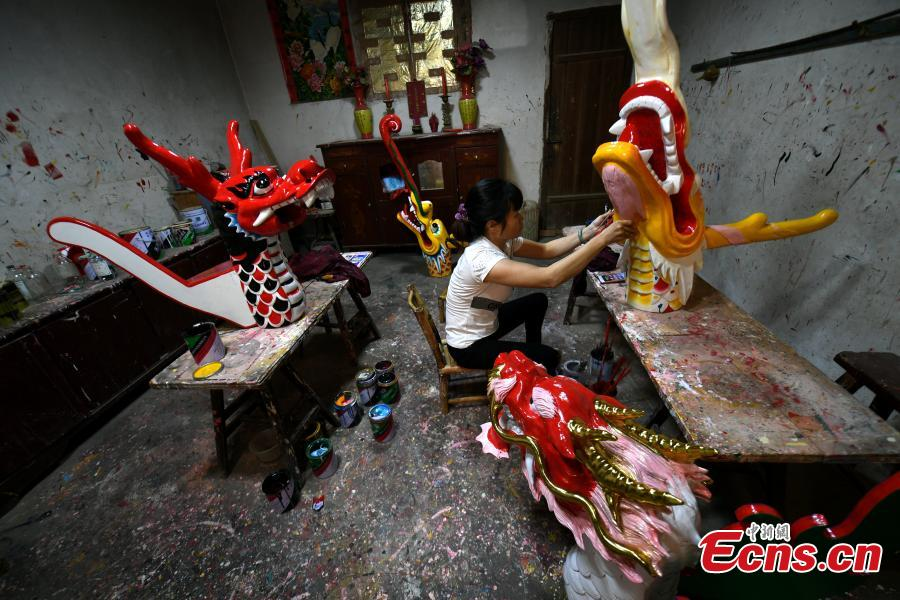 Heads of dragon boats are painted at a factory in Fangzhuang Village, Minhou County, East China's Fujian Province, May 30, 2018. The village has a 700-year history of dragon-boat making. As fewer young people work to inherit the skills of the traditional craft, the village is now home to just four factories still using ancient simple tools to make the handmade boats. The Dragon Boat Festival is celebrated on the fifth day of the fifth month of the Chinese lunar calendar and falls on June 18 this year. (Photo: China News Service/Wang Dongming)