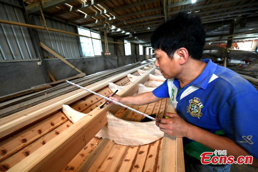 A man works in a dragon boat-making factory in Fangzhuang Village, Minhou County, East China's Fujian Province, May 30, 2018. The village has a 700-year history of dragon-boat making. As fewer young people work to inherit the skills of the traditional craft, the village is now home to just four factories still using ancient simple tools to make the handmade boats. The Dragon Boat Festival is celebrated on the fifth day of the fifth month of the Chinese lunar calendar and falls on June 18 this year. (Photo: China News Service/Wang Dongming)