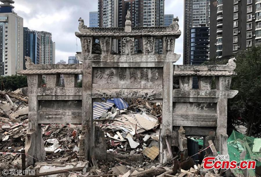 A memorial archway from the Qing Dynasty (1644-1911) has been discovered during renovation work in a community in Guiyang City in Southwest China's Guizhou Province. The eight-meter-tall, nine-meter-wide structure was originally constructed to honor the filial piety of a woman to her parents-in-law in 1841. The existence of the cultural relic has only recently been publicly known as it was long hidden in a private residence. (Photo/VCG)