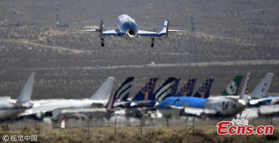 Virgin Galactic has conducted the second rocket-powered test flight of its tourism spaceship in the skies over Southern California. The company said VSS Unity fired its rocket motor for 31 seconds and climbed to an altitude of 114,500 feet (34899.6 meters) on Tuesday, May 29, 2018, then glided to a landing at Mojave Air and Space Port. (Photo/VCG)