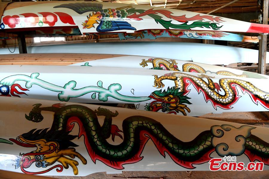 A close-up view of patterns on a dragon boat in Fangzhuang Village, Minhou County, East China's Fujian Province, May 30, 2018. The village has a 700-year history of dragon-boat making. As fewer young people work to inherit the skills of the traditional craft, the village is now home to just four factories still using ancient simple tools to make the handmade boats. The Dragon Boat Festival is celebrated on the fifth day of the fifth month of the Chinese lunar calendar and falls on June 18 this year. (Photo: China News Service/Wang Dongming)
