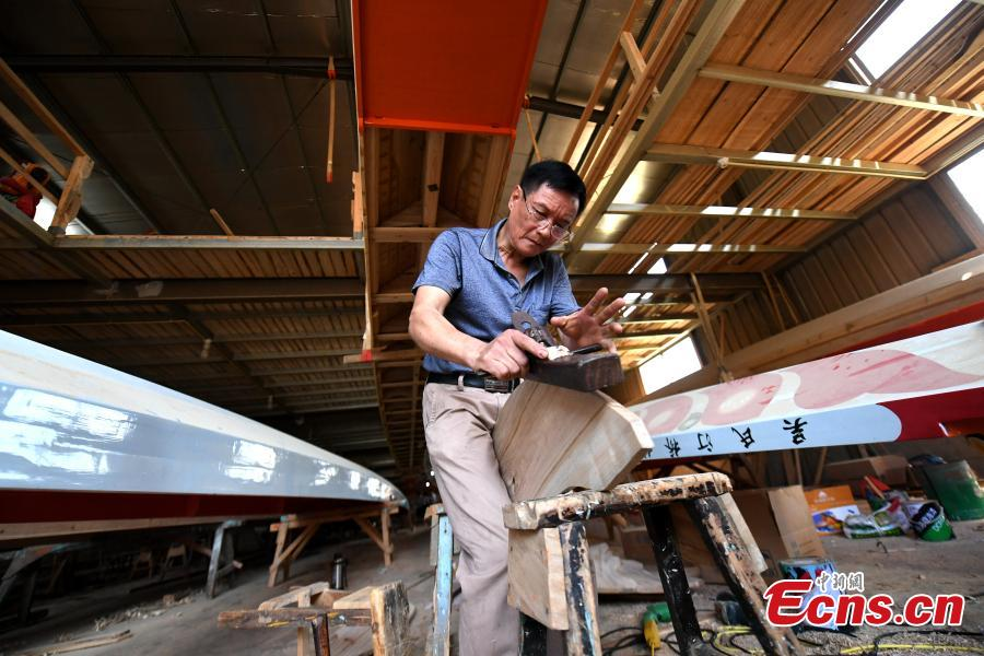 Fang Shaofang works in a dragon boat-making factory in Fangzhuang Village, Minhou County, East China's Fujian Province, May 30, 2018. The village has a 700-year history of dragon-boat making. As fewer young people work to inherit the skills of the traditional craft, the village is now home to just four factories still using ancient simple tools to make the handmade boats. The Dragon Boat Festival is celebrated on the fifth day of the fifth month of the Chinese lunar calendar and falls on June 18 this year. (Photo: China News Service/Wang Dongming)