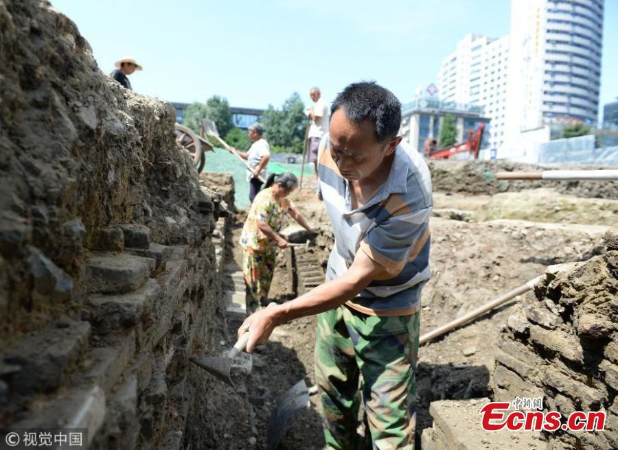 A view of an excavation at a construction site near Chunxi Road in Chengdu City, Southwest China's Sichuan Province. Experts from the Chengdu Institute of Relics and Archaeology found remains of streets and buildings dating back to the late Tang Dynasty (618-907) to Southern Song Dynasty (960-1279) at the site, believing the findings are important to understand city layout and architecture in ancient China. (Photo/VCG)