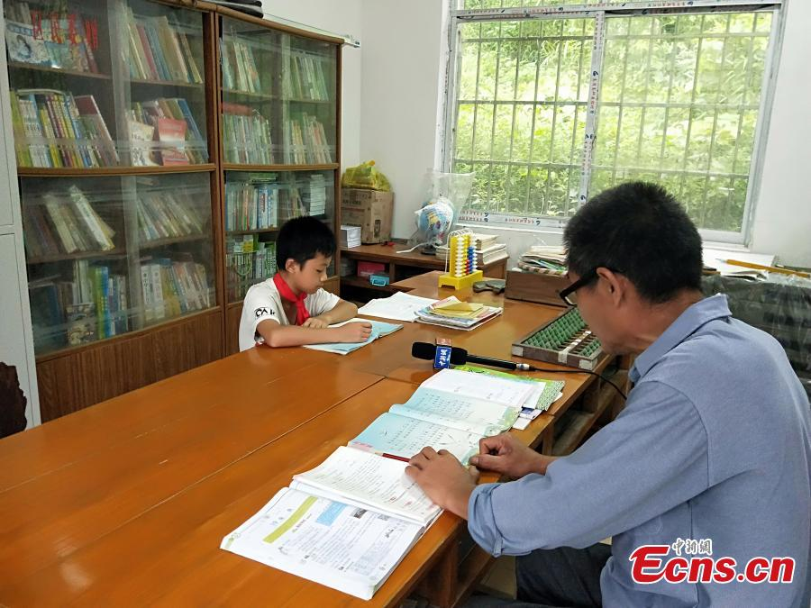 Pan Shanji, 58, is the only teacher at Dayadong Primary School, teaching six subjects to his only student, Li Jianwen, May 31, 2018. Pan began teaching in Sept. 1979 and has taught at three rural primary schools, including 28 years at Dayadong Primary School. (Photo: China News Service/Cao Weijun)