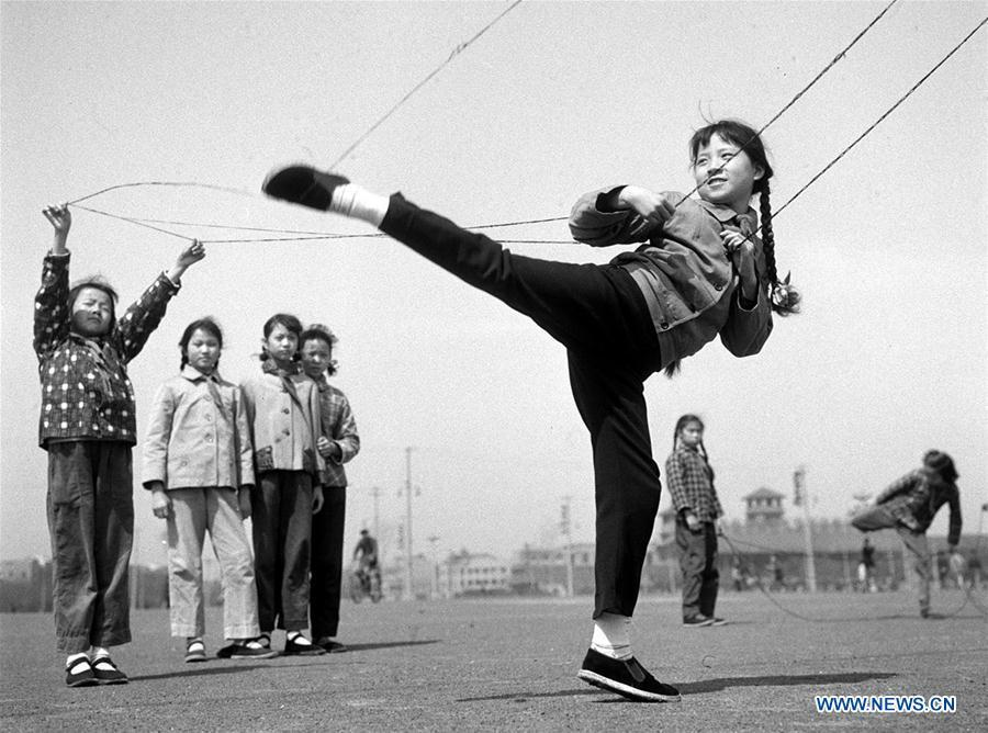 In this file photo issued on July 6, 1963, girls play Chinese jump rope in east China\'s Shanghai. As China celebrates the International Children\'s Day, there arises the occasion for grown-ups to think back over the joys of childhood. With the evolution of technology and lifestyle, children are exposed to a wider range of entertainment. Nevertheless, joy would remain a childhood motif no matter how its forms change with time. (Xinhua/Xia Daoling)