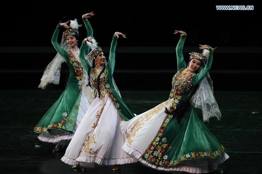Chinese dancers perform during a folk dance show of the Shanghai Cooperation Organization (SCO) art festival held in Beijing, capital of China, June 1, 2018. (Xinhua/Shen Bohan)