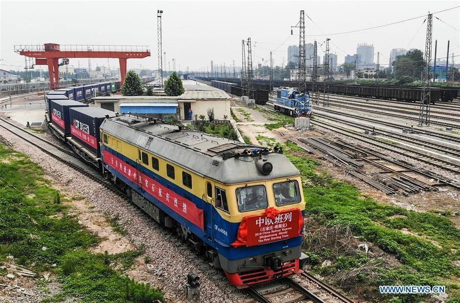 Photo taken on June 2, 2018 shows a China Railway (CR) Express cargo train leaving for Minsk from Shijiazhuang, north China\'s Hebei Province. The first China-Europe CR Express cargo train from Shijiazhuang to Minsk left on Saturday. (Xinhua/Liu Peiran)