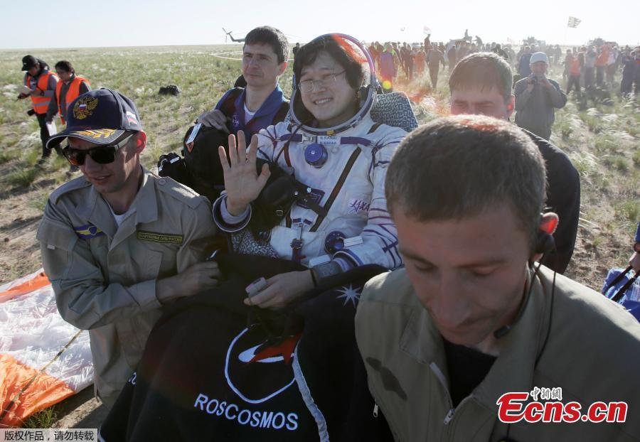 Ground personnel carry International Space Station crew member Norishige Kanai of Japan to get out of the Soyuz MS-07 space capsule shortly after landing in a remote area outside the town of Dzhezkazgan, Kazakhstan June 3, 2018. (Photo/Agencies)