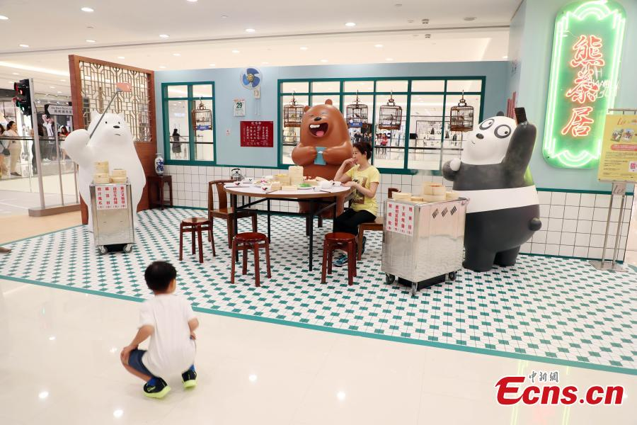 Grizzly, Panda and Ice Bear from Cartoon Network's We Bare Bears are having their first working holiday at LCX, Ocean Terminal in Hong Kong. Visitors can snap a selfie with them as they visit a famous local teahouse, herbal tea kiosk, traditional grocery store and egg waffles stall. Their visit runs until June 17. (Photo: China News Service/Hong Shaokui)