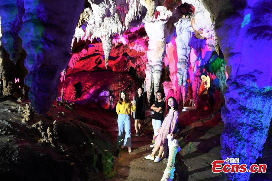 A view of illuminated stalactite formations at the Jixingyan scenic area in Debao County, South China's Guangxi Zhuang Autonomous Region, June 3, 2018. Jixingyan is a 4A tourist attraction, the second-highest on China's tourism scale. (Photo: China News Service/Chen Wen)