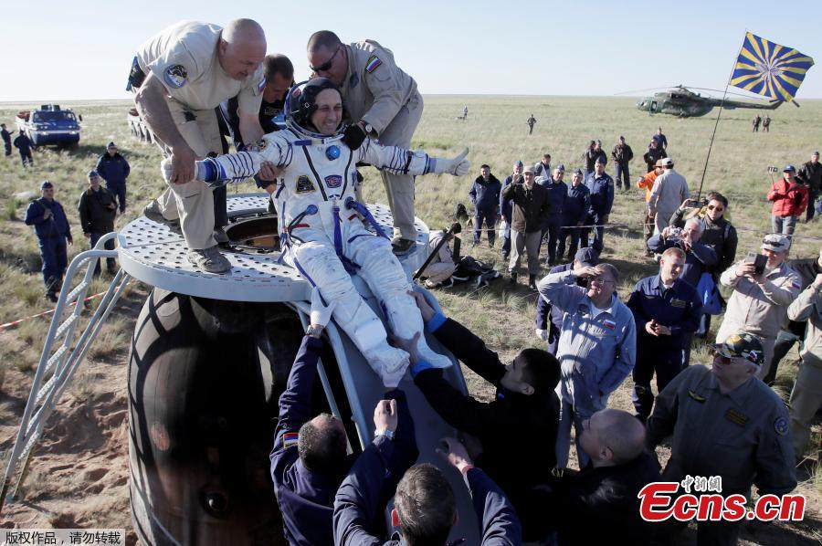Ground personnel help International Space Station crew member Anton Shkaplerov of Russia to get out of the Soyuz MS-07 space capsule shortly after landing in a remote area outside the town of Dzhezkazgan, Kazakhstan June 3, 2018. (Photo/Agencies)