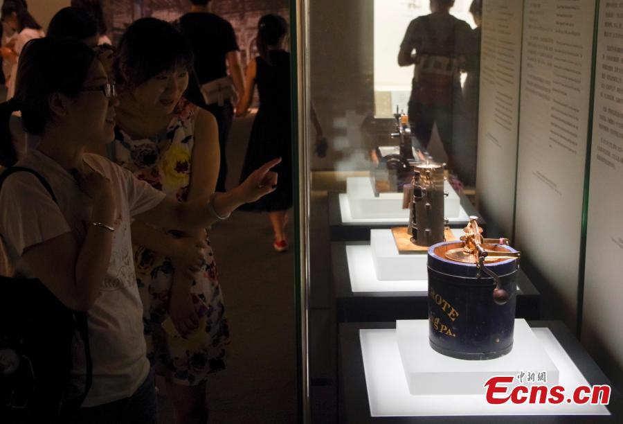 Visitors view items in the Spirit of Invention: Nineteenth-Century U.S. Patent Models from the Hagley Museum and Library exhibition at the National Museum of China in Beijing, June 3, 2018. The exhibition presented 60 of Hagley's 19th-century patent models. (Photo: China News Service/Jia Tianyong)